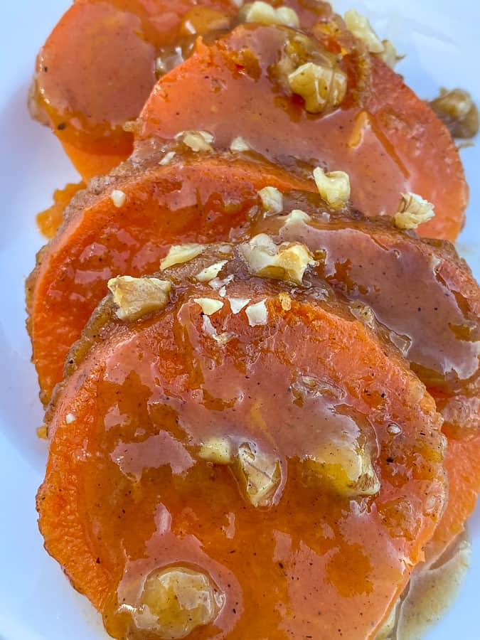 Slices of a sweet potato casserole with a glaze