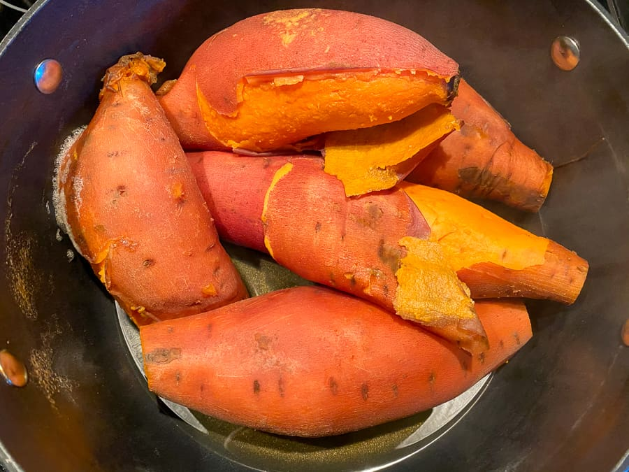 Boiled sweet potatoes with skin falling off