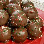 Beautiful peanut butter rice crispy balls with sprinkles on red plate