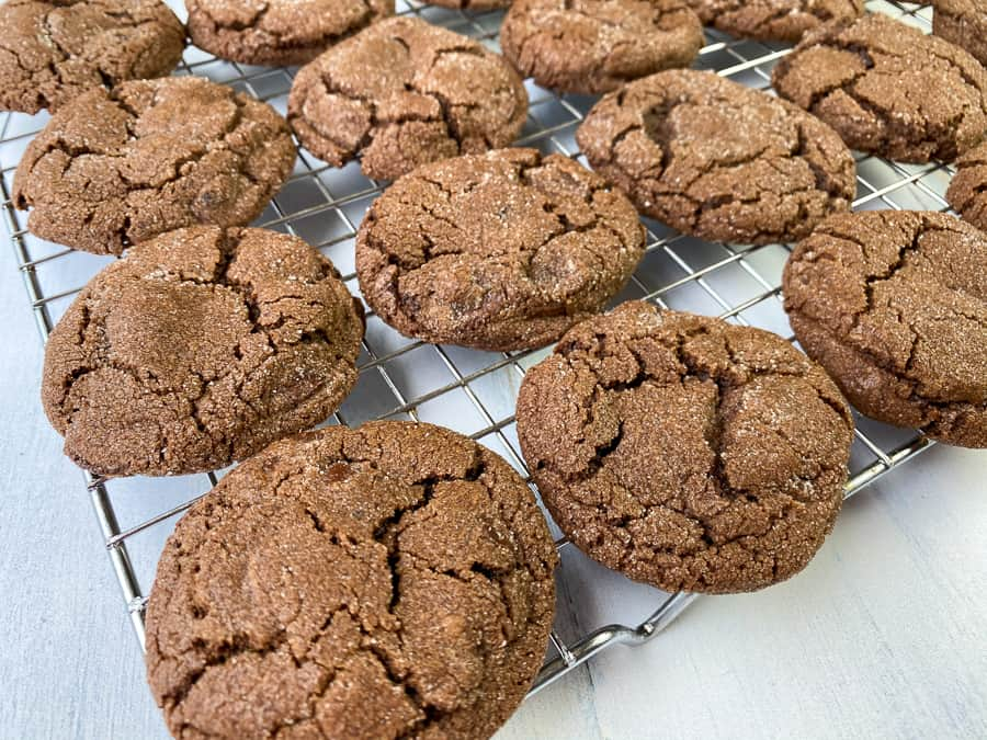 Baking rack covered in triple chocolate chunk cookies