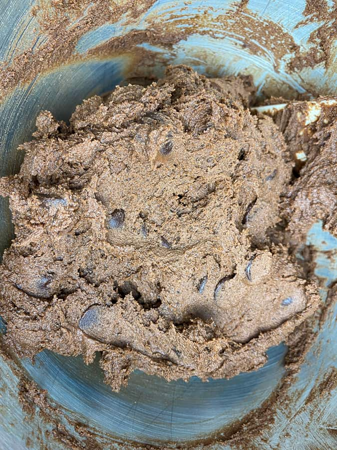 Triple chocolate chunk cookie dough in mixing bowl