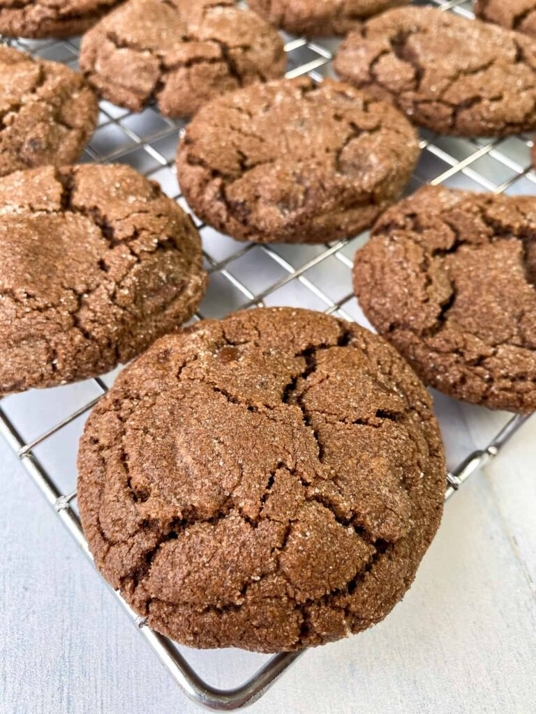Triple chocolate chunk cookies with crack on a cooling rack