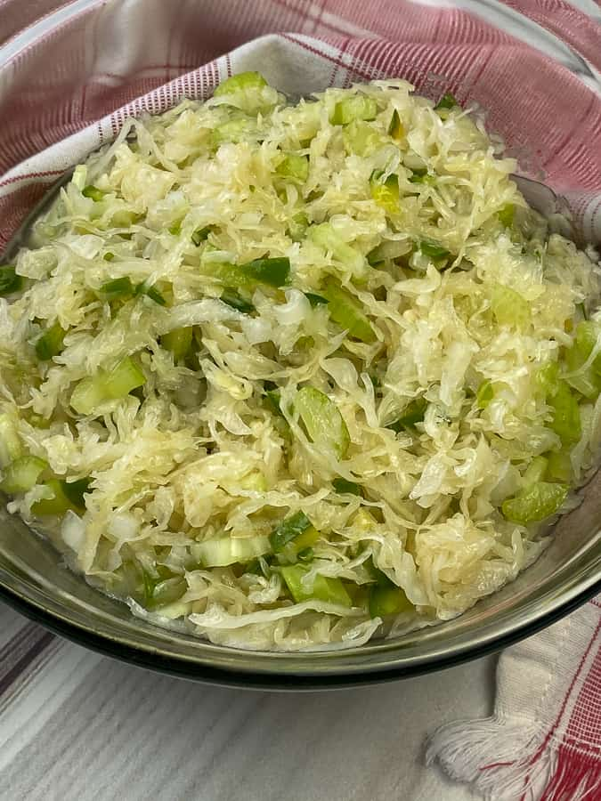 Amish sauerkraut salad on white table with napkin