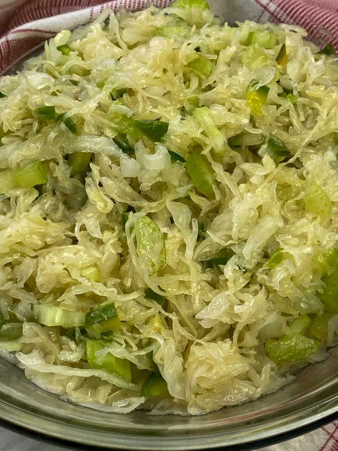 Cold sauerkraut marinating in simple dressing in bowl