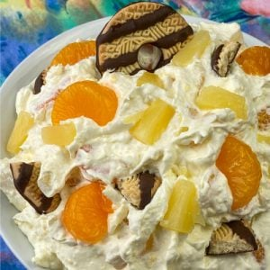 Striped Keebler Fudge cookies in a fruit salad with pineapple tidbits and mandarin oranges