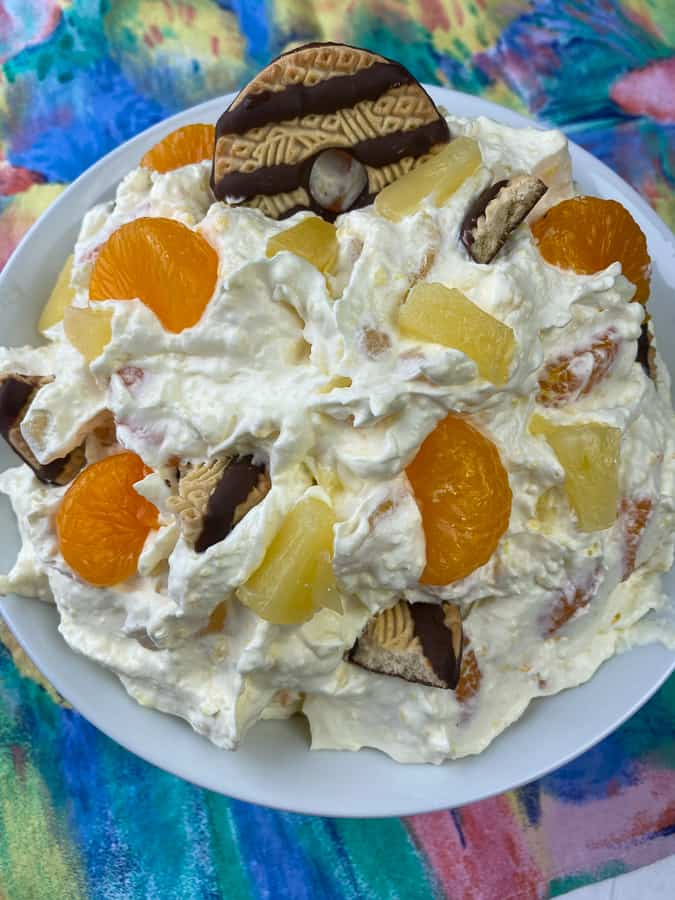 Mandarin oranges and pineapple in a fluff dessert salad with fudge striped cookies