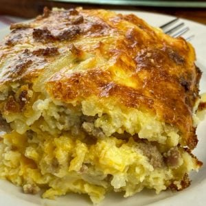 Close-up piece of sausage and hash brown breakfast casserole