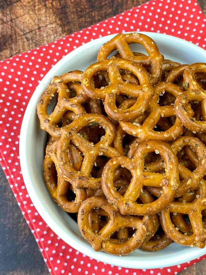 White dish with spicy pretzels on red napkin