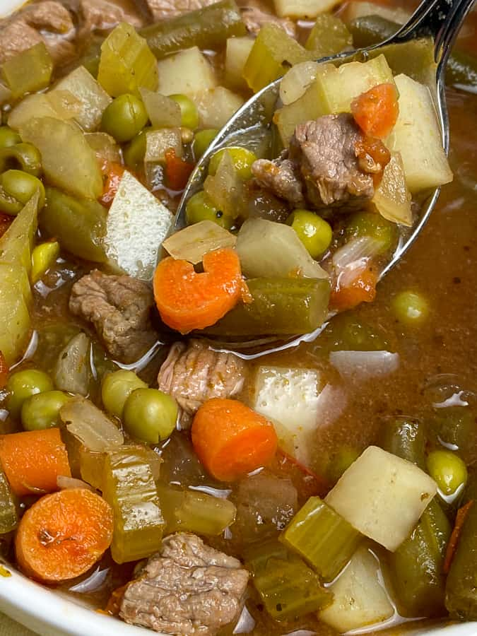 Spoonful of vegetable and beef soup