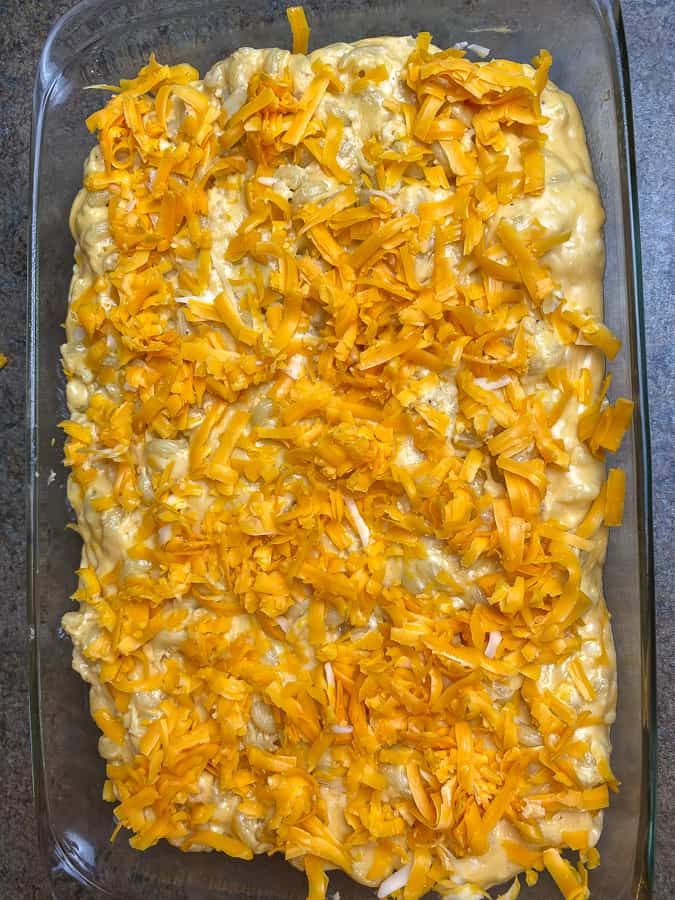 Sharp cheddar sprinkled on top of mac and cheese
