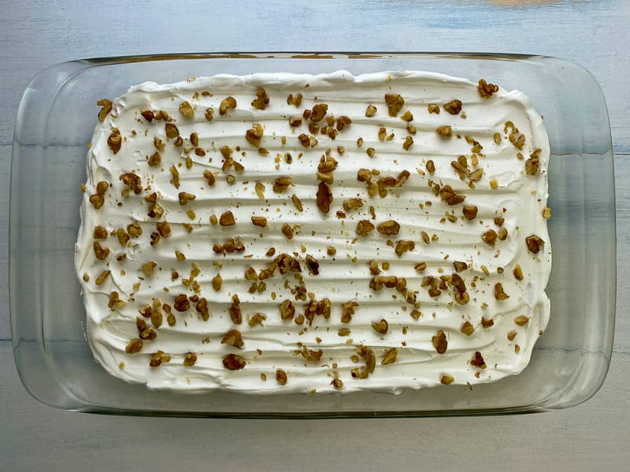 Chopped nuts and Cool Whip on top of butterscotch surprise dessert