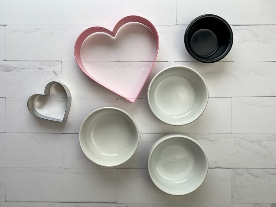 Small dishes and cookie cutters to be used to create a charcuterie board