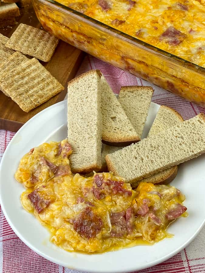 Reuben dip with corned beef on plate with crackers and toast sticks
