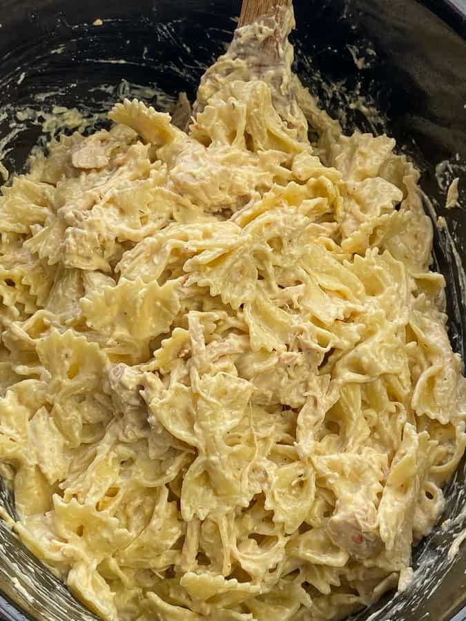 Bowtie pasta stirred into creamy chicken to make a casserole