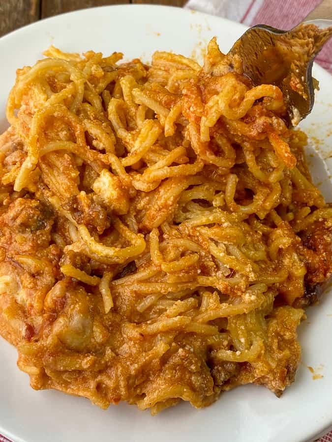 Fork in spaghetti casserole with Italian sausage