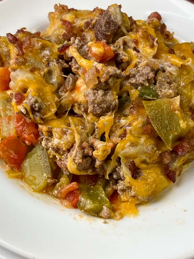 Delicious cheeseburger and vegetable casserole on white plate