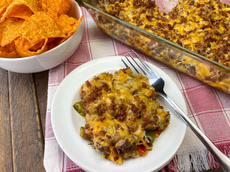 Doritos next to ground beef and bacon casserole covered with cheese