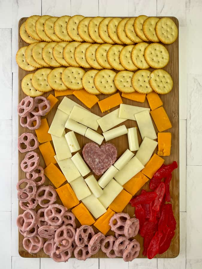 A charcuterie board made by kids for an easy lunch or fun party with meat, cheese and crackers