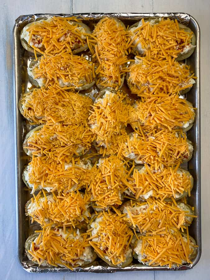 Shredded cheddar cheese on top loaded baked potatoes