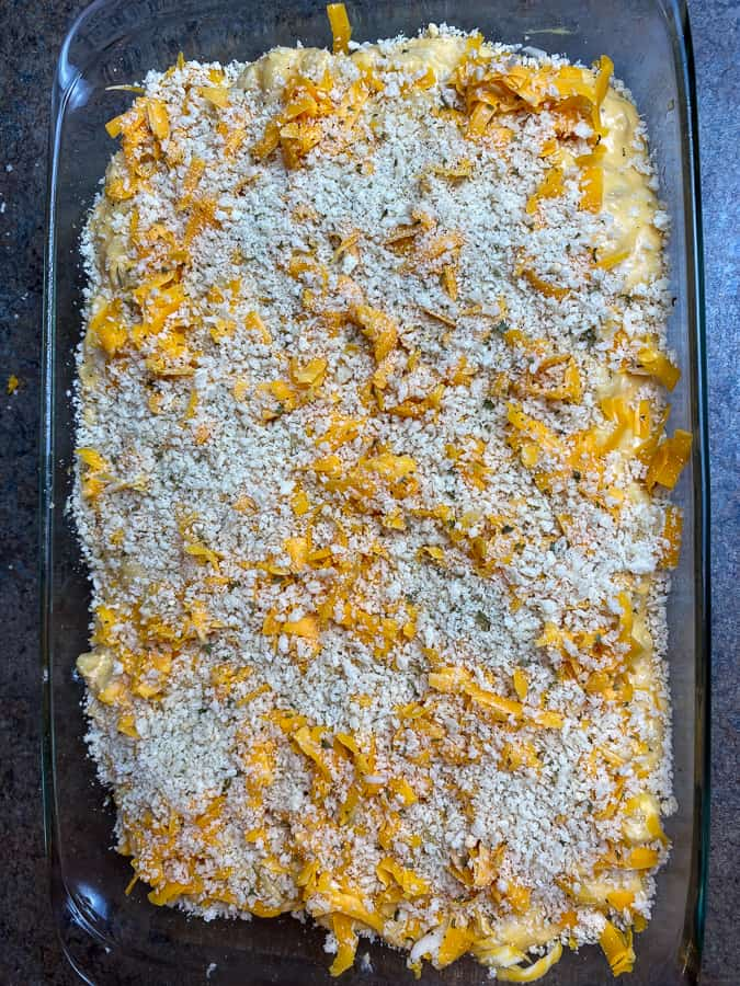 Panko breadcrumbs sprinkled on top of unbaked mac and cheese