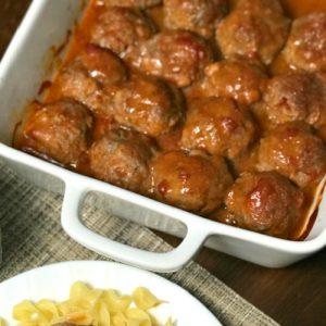 Dish of oven baked farmhouse applesauce meatballs