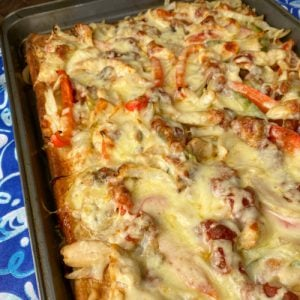 The best cheesy fajita pizza with onions, pepper, mushrooms and chicken.