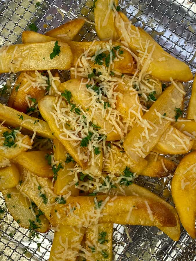 Steak fries bathed in garlic butter and loaded with shredded Parmesan cheese