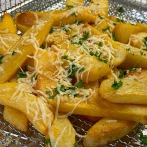 Steak fries loaded with parmesan cheese, parsley and garlic