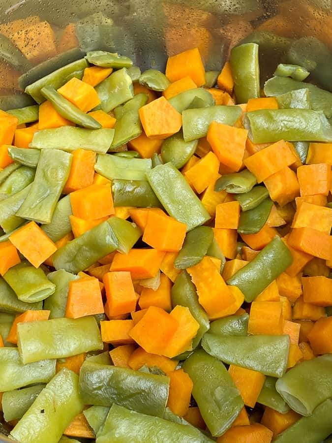 Cooked sweet potato cubes and Italian style green beans in the Instant Pot