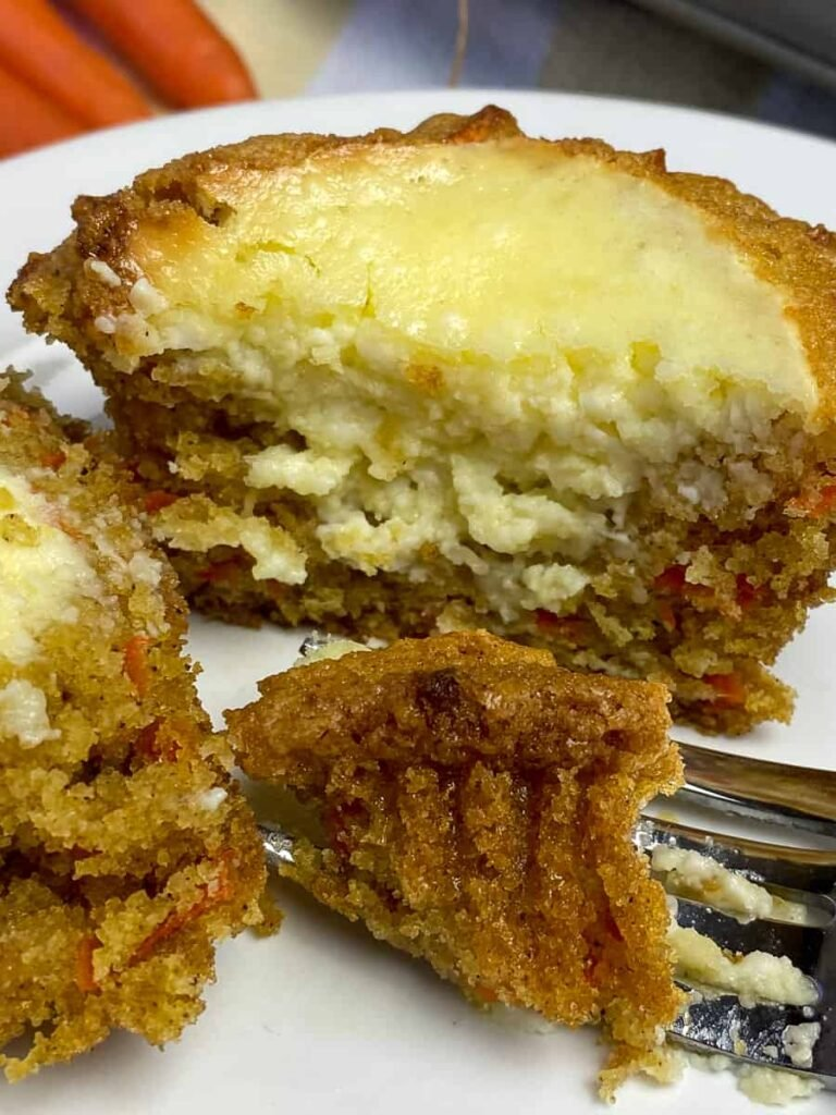 Fork of carrot cake muffin and cream cheese filling
