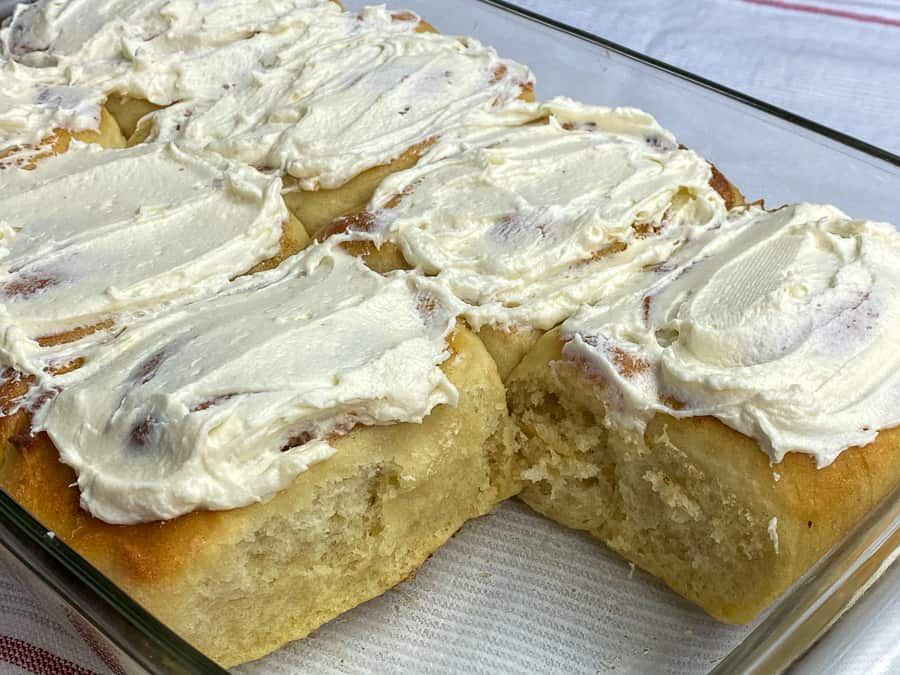 Baking pan of ermine frosted giant homemade cinnamon rolls