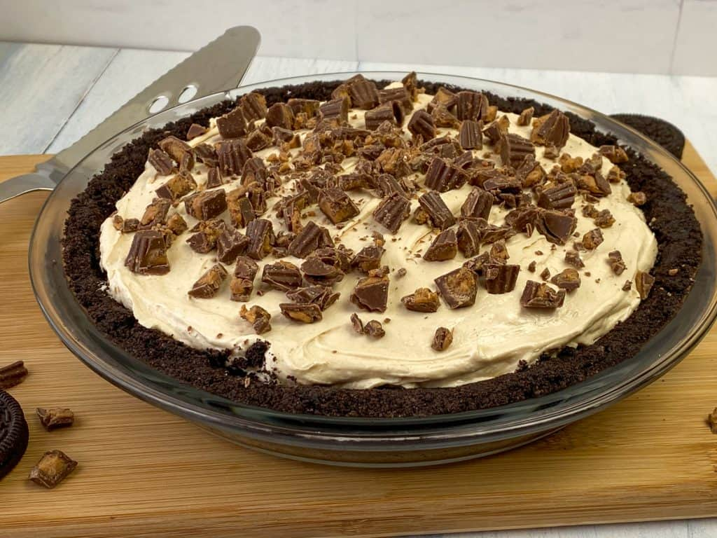 No-bake Oreo peanut butter pie topped with chopped Reese's peanut butter cups