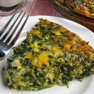 Slice of crustless spinach bacon quiche