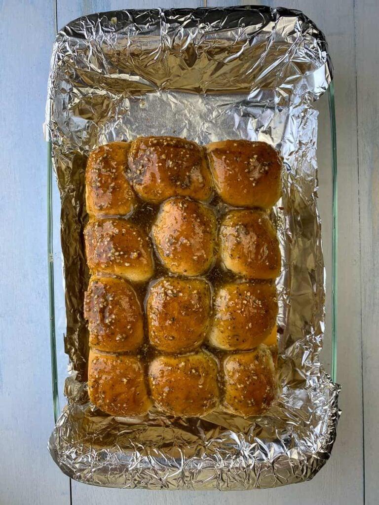 Sweet glaze on Hawaiian roll sliders in foil lined pan