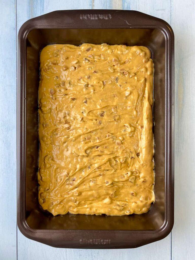 Butterscotch batter spread in baking pan