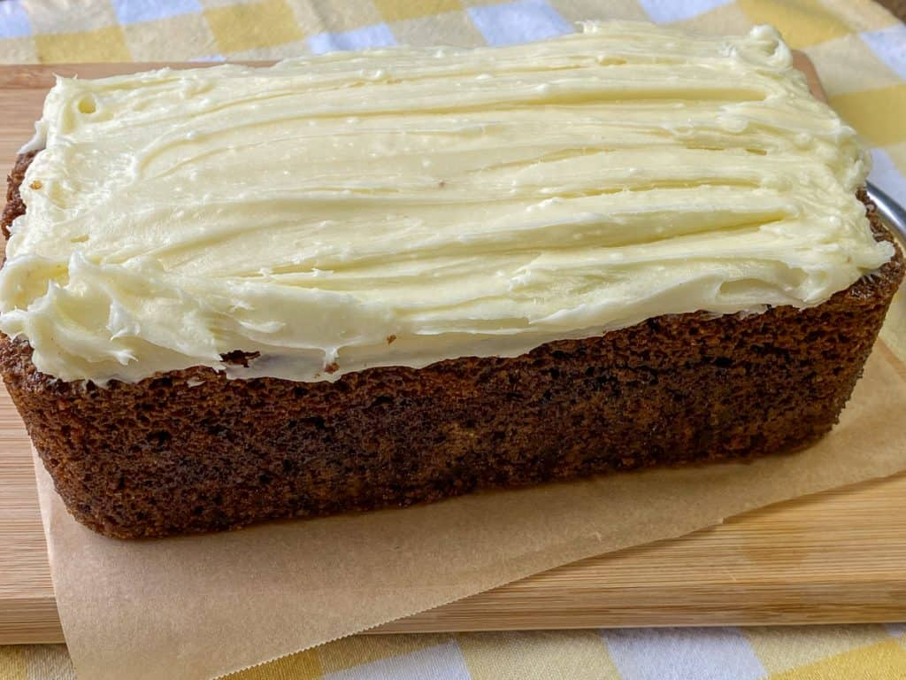 Carrot cake made in a loaf pan with cream cheese icing