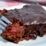 Fork full of chocolate and cherry dessert