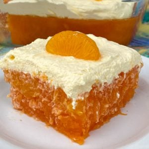 Cool whip frosting on classic orange jello salad