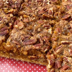 Pecan covered pie bars in baking dish