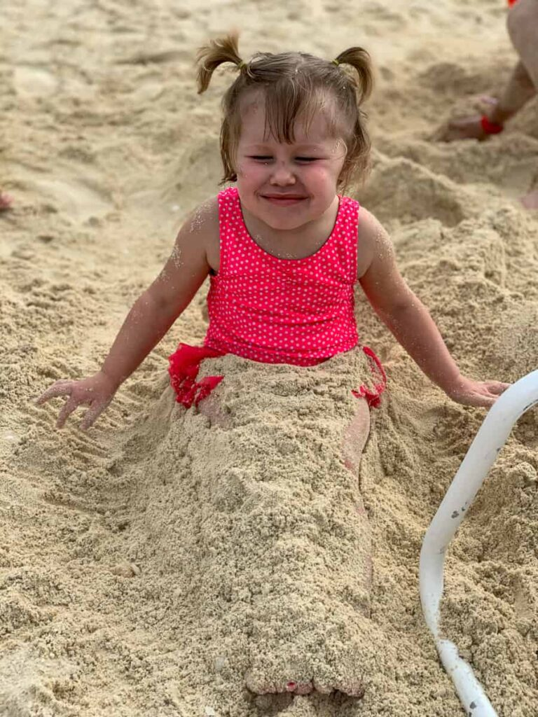 Toddler covered in sand on the Castaway Cay island
