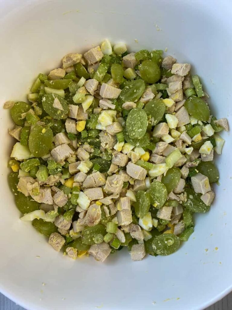 Chicken salad ingredients stirred together
