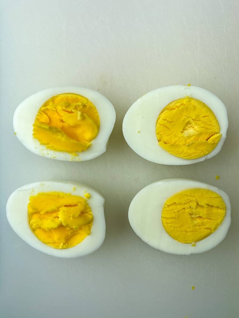 Properly cooked hard-boiled eggs next to eggs that are too soft and undercooked