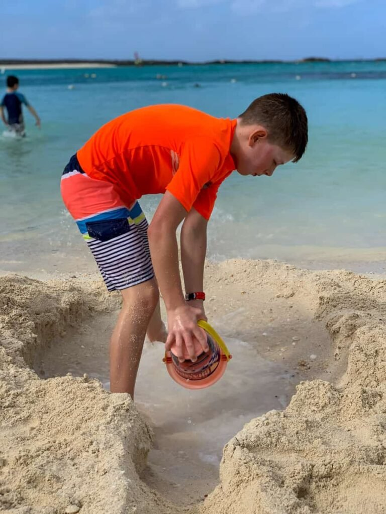 Kid playing on the beach at Disney's private island