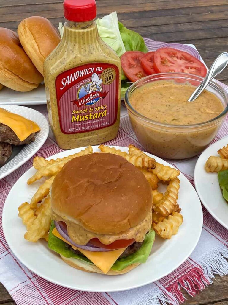 Good burger sauce on a sandwich with fries