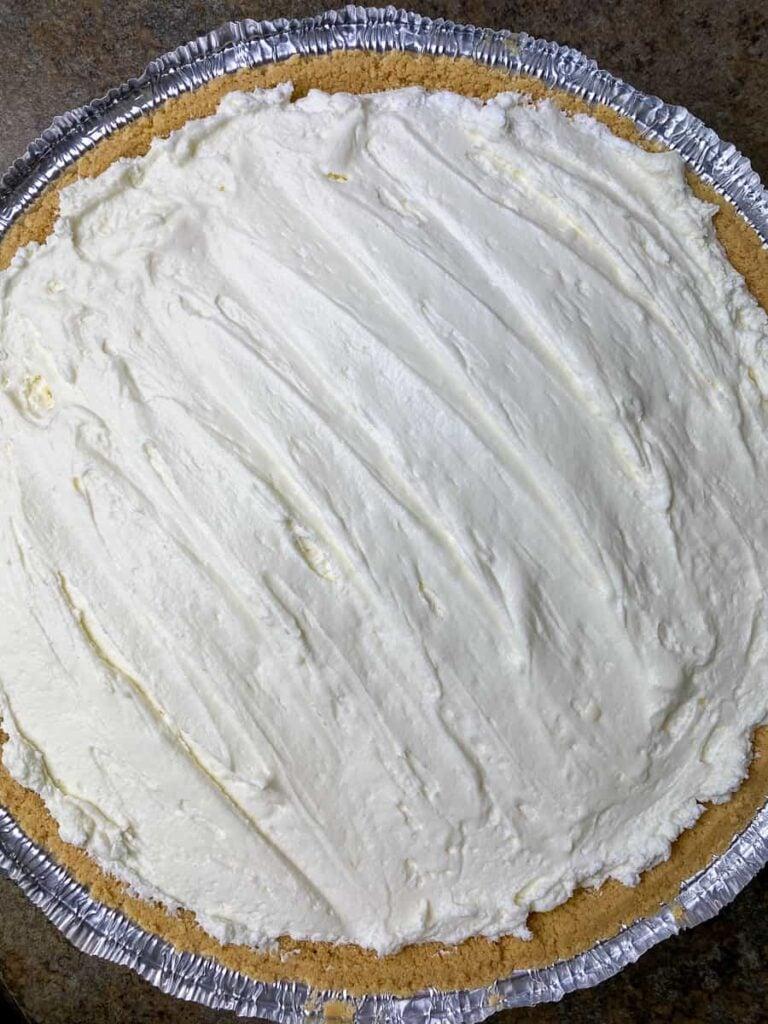 Cheesecake in large graham cracker crust