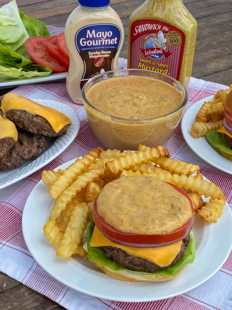 Woebers mustard and mayo mixed in a burger sauce and spread on top of a grilled hamburger