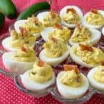 Bacon jalapeno deviled eggs in an egg tray