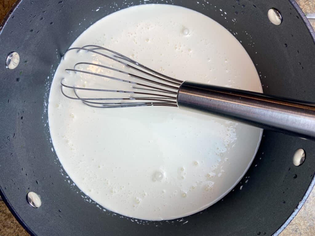 Stirring milk into sugar, flour and salt mixture