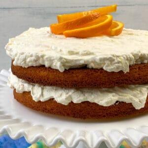 Homemade cake with fresh orange juice and lemon juice on a cake stand