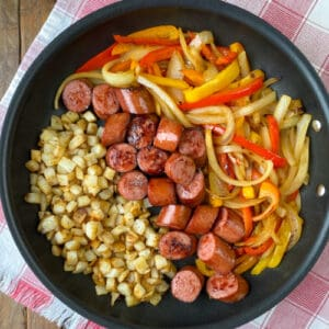 Skillet of sausage, peppers, onions and fried potatoes